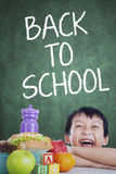 Boy with his lunch back to school Stock Image