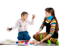 Boy and his mom play with bright paint Stock Image