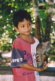 Portrait of a boy and his monkey friend, Borneo, Indonesia Royalty Free Stock Image