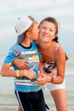 The boy with his mother on the beach Stock Image