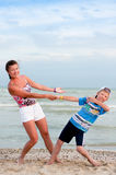 The boy with his mother on the beach Royalty Free Stock Image