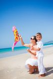 Boy with his mother flying kite Stock Photography