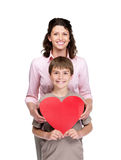 Boy with his mother holding a heart sign together Stock Image