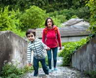 A boy and his mother in the old town. A boy and his mother are walking in the old town. A women travels with her son in historical places. The child is walking Royalty Free Stock Image