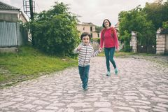 A boy and his mother in the old town. A boy and his mother are walking in the old town. A woman travels with her son in historical places. The child is walking Royalty Free Stock Photography