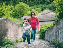 A boy and his mother in the old town. A boy and his mother are walking in the old town. A woman travels with her son in historical places. The child is walking royalty free stock images