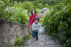 A boy and his mother in the old town. A boy and his mother are walking in the old town. A women travels with her son in historical places. The child is walking royalty free stock photo