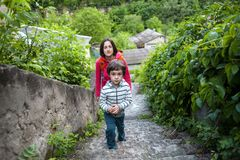A boy and his mother in the old town. A boy and his mother are walking in the old town. A women travels with her son in historical places. The child is walking royalty free stock photos