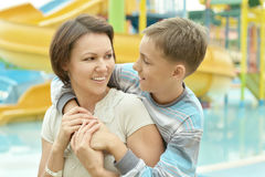 Boy with his mother Stock Images