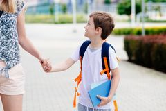Boy with his mother at road to school. Stock Images