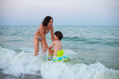 A boy with his mother on the seashore. Stock Photography