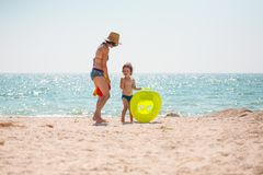 A boy with his mother on the seashore. Royalty Free Stock Images