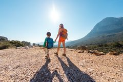 The boy and his mother are standing on the top of the mountain royalty free stock photo