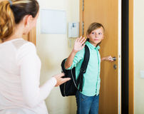 Boy and his mother staying near flat entrance Royalty Free Stock Photography