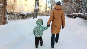 Boy and his mother are walking stock footage