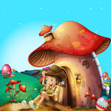 A boy at his mushroom house Stock Photography