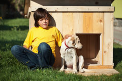 Boy with his new puppy sitting Royalty Free Stock Photos