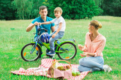 Boy With His Parents In The Park Stock Images