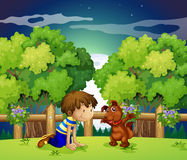 A boy and his pet playing outdoor Stock Images