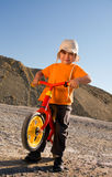 Boy on his red balance bike Royalty Free Stock Photo