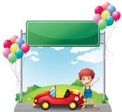 A boy with his red car below an empty board Stock Photos