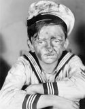 Boy in his sailors  outfit with dirty face Stock Photography