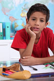 Boy on his school desk Royalty Free Stock Image