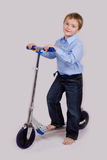 Boy on his scooter Stock Photo
