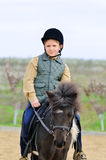 Boy and his Shetland pony Stock Image