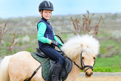 Boy and his Shetland pony Royalty Free Stock Photo