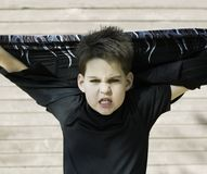 Boy with his shirt behind his head Royalty Free Stock Photos