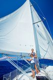 Boy with his sister on board of sailing yacht on summer cruise. Travel adventure, yachting with child on family vacation stock photos