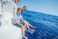 Boy with his sister on board of sailing yacht on summer cruise. Travel adventure, yachting with child on family vacation royalty free stock image