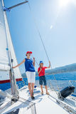 Boy with his sister on board of sailing yacht on summer cruise. Royalty Free Stock Photos