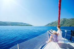 Boy with his sister on board of sailing yacht on summer cruise. Travel adventure, yachting with child on family vacation stock photo