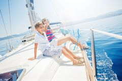 Boy with his sister on board of sailing yacht on summer cruise. Travel adventure, yachting with child on family vacation royalty free stock photos