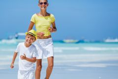 Boy with his sister having fun on tropical ocean beach. Kid during family sea vacation. Stock Image