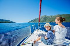Boy with his sister on board of sailing yacht on summer cruise. Travel adventure, yachting with child on family vacation Royalty Free Stock Photography