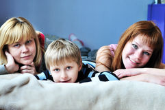 Boy with his sister and mother royalty free stock photography