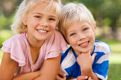 Boy with his sister outside Royalty Free Stock Photo