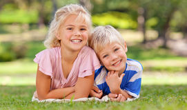 Boy with his sister in the park Stock Photography