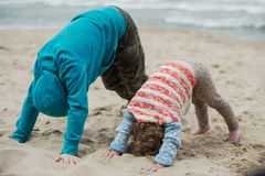 Boy with his sister playing on the beach. Summer vacation with children at the sea. Outdoor play Royalty Free Stock Photos