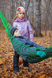 A boy with his sister relaxing in a hammock Royalty Free Stock Photos