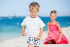 Boy with his sister walking Stock Photography