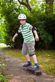 Boy on his skate board Royalty Free Stock Photos