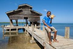 Boy and his starfish royalty free stock photos