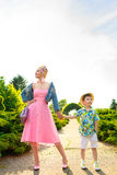 Boy and his stylish motherposing  in park Royalty Free Stock Photography