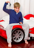 Boy and his supercar bed with keys. Boy and his supercar bed Stock Photo
