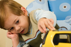 Boy with his toy car Royalty Free Stock Images