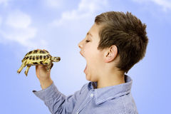 Boy with his turtle. Boy with open mouth holding turtle Stock Images